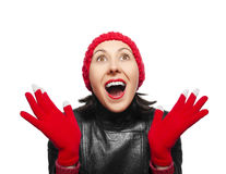 Surprised young woman looking up. Surprised young woman in leather jacket and hat looking up Stock Images
