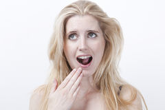 Surprised young woman with mouth open against white background Royalty Free Stock Photos