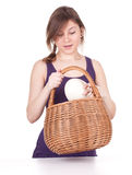 Surprised young woman with ostriches egg Stock Photography