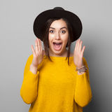Surprised young woman over gray background Stock Photo