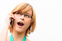 Surprised young woman on phone Stock Image