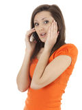 Surprised young woman on the phone Royalty Free Stock Photography