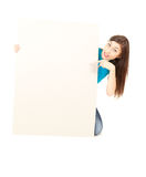 Surprised young woman pointing on blank poster Royalty Free Stock Photography