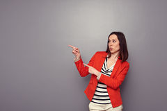 Woman pointing at copyspace Royalty Free Stock Images