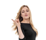 Surprised young woman pointing and looking up. Royalty Free Stock Images