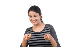 Surprised young woman pointing at a product Royalty Free Stock Photos