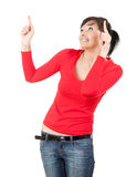 Surprised young woman pointing up Stock Image