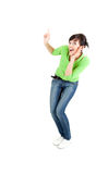 Surprised  young woman pointing up Royalty Free Stock Images
