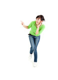 Surprised  young woman pointing up Stock Images
