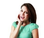 Surprised young woman. Portrait of a surprised young woman with hands over her mouth laughing against white background Stock Images