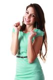 Surprised young woman. Portrait of a surprised young woman with hands over her mouth laughing against white background Stock Image
