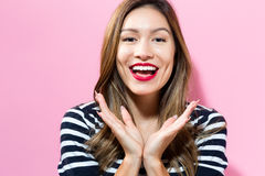 Surprised young woman posing Stock Image