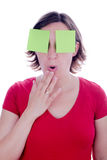 Surprised young woman post-it on her eyes Stock Photo