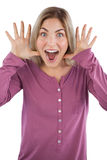 Surprised young woman raising hands Royalty Free Stock Photography