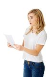 Surprised young woman reading some notes Royalty Free Stock Photography