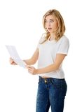 Surprised young woman reading some notes Stock Image