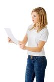 Surprised young woman reading some notes Royalty Free Stock Image