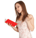 Surprised young woman with red book Royalty Free Stock Photos