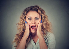 Surprised young woman shouting looking at camera Royalty Free Stock Photo