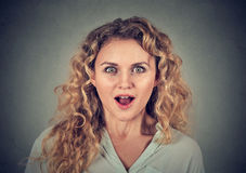 Surprised young woman shouting looking at camera Stock Images