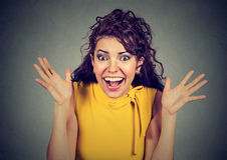 Surprised young woman shouting looking at camera. Surprised young woman shouting over gray background. Looking at camera Royalty Free Stock Photo