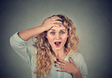 Surprised young woman shouting Stock Photos