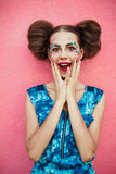 Surprised young woman shouting over pink background. Looking at camera Stock Photography