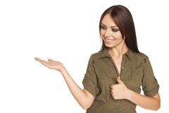 Surprised young woman showing open hand palm Royalty Free Stock Photos