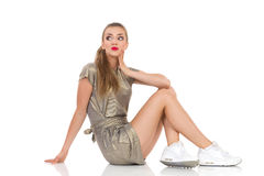 Surprised Young Woman Sitting Royalty Free Stock Images