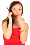 Surprised young woman speaks by a mobile phone Stock Image