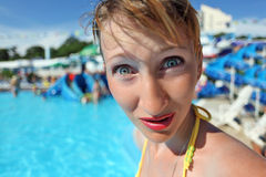 Surprised young woman standing in pool Royalty Free Stock Photography