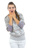 Surprised young woman in sweater looking on copy space Stock Images