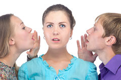 Surprised young woman and two people Royalty Free Stock Images