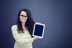 Surprised young woman using holding a digital tablet Royalty Free Stock Image