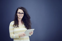 Surprised young woman using holding a digital tablet Royalty Free Stock Photography