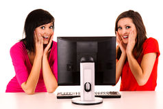 Surprised young women studying with the computer Stock Images