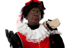 Surprised Zwarte piet ( black pete) typical Dutch. Character part of a traditional event celebrating the birthday of  Sinterklaas in december over white Stock Images