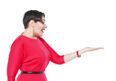 Surprisedl plus size woman in red dress looking on her palm Royalty Free Stock Photography