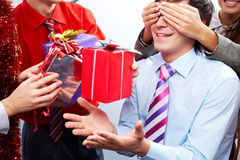 Surprising. Image of man guessing what present he is going to receive from his colleagues Royalty Free Stock Photos