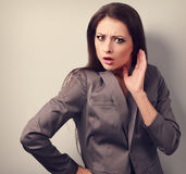 Surprising angry business woman with hand near face. Toned close Stock Images