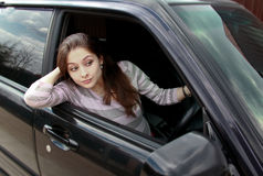 Surprising beautiful woman looking from car Stock Photography