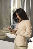 Surprising businesswoman with tablet Stock Image