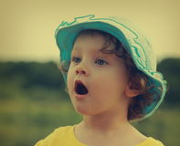 Surprising fun child with opened Royalty Free Stock Images