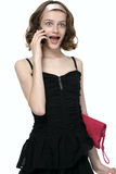 Surprising girl talking with mobile phone. Portrait of young girl with open mouth royalty free stock photos
