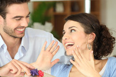 Surprising his girlfriend with gift Stock Images