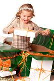 Surprising little girl between gifts royalty free stock photos