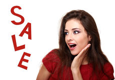 Surprising makeup woman looking on sale text with open mouth Royalty Free Stock Image
