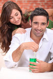 Surprising man with cocktail Royalty Free Stock Image