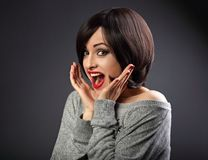 Surprising very excite woman looking with open mouth on dark gre. Y background. Closeup portrait Stock Photography