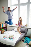Surprisingly high jump of dad Stock Photos